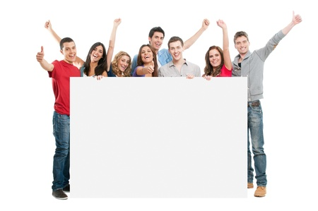 Happy joyful large group of friends diplaying white placard for your text isolated on white background
