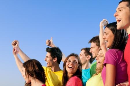 Foto de Happy joyful group of young friends staying together with fun outdoor - Imagen libre de derechos