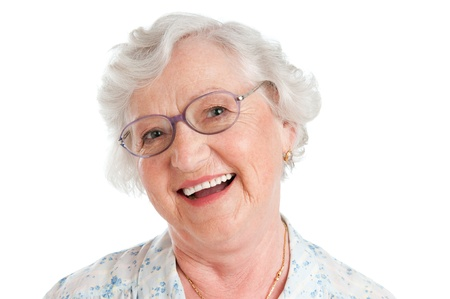 Photo for Happy smiling senior lady looking at camera with her glasses isolated on white background - Royalty Free Image