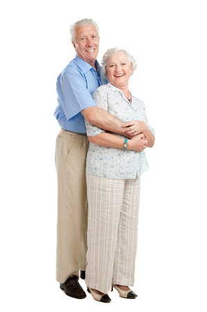 Satisfied smiling senior couple standing full length together isolated on white backgroundの写真素材