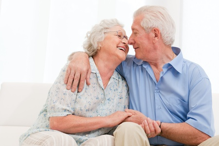 Happy joyful aged couple loving and enjoy the retirement at homeの写真素材