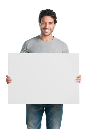 Happy young man showing and displaying placard ready for your text or product