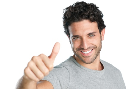 Happy smiling guy showing thumb up hand sign isolated on white backgroundの写真素材