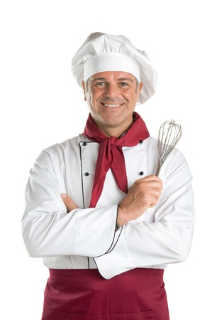 Happy mature professional chef holding a whisk and looking at camera isolated on white background