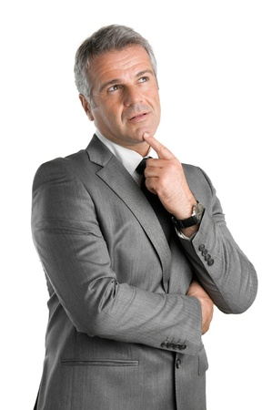 Photo pour Pensive businessman looking up with pensive expression isolated on white background - image libre de droit