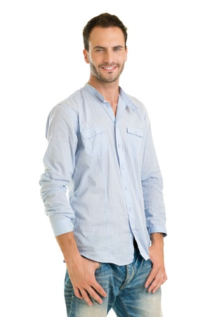 Handsome Man Standing Casually Dressed Against White Background