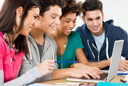 Group of Happy Friends Working On Laptop in Class