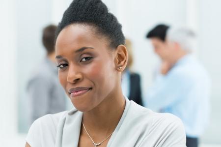 Foto de Portrait Of Young African American Businesswoman In Her Office - Imagen libre de derechos