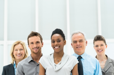 Smiling multi ethnic business team with copy space