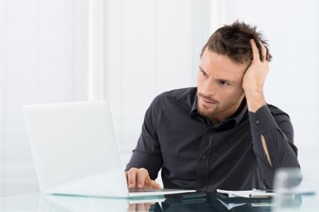 Stressed Man Working On Laptop