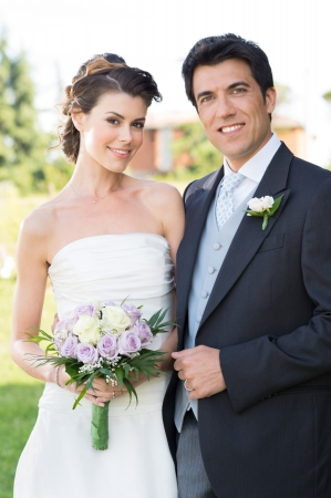 Foto de Portrait Of Happy Beautiful Young Married Couple Otdoor - Imagen libre de derechos