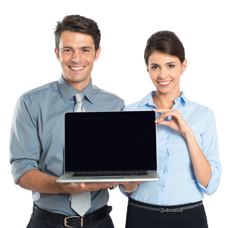 Happy Young Businessman And Businesswoman Showing Laptop Isolated On White Backgroundの写真素材