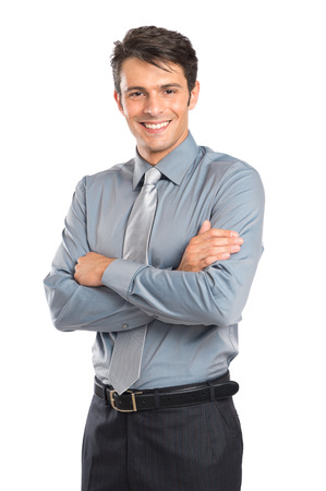 Photo pour Portrait Of Happy Young Businessman With Arm Crossed Isolated On White Background - image libre de droit