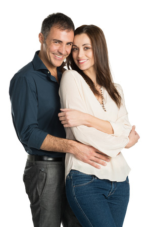 Portrait Of A Embracing Couple Looking At Camera Isolated On White