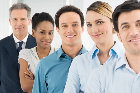 Group Of Happy Multi Multiethnic Businesspeople Looking At Camera