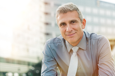 Foto de Closeup Of Happy Mature Businessman Smiling Outdoor - Imagen libre de derechos