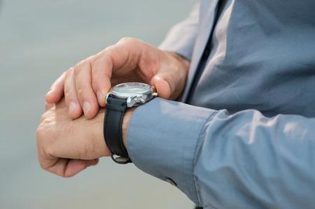 Closeup Of Businessman Hands Checking Time