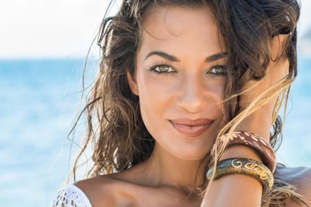 Close Up Of Carefree Girl Looking At Camera At Tropical Beach