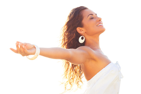 Photo for Smiling Relaxed Young Woman Extending Her Arms And Closing Her Eyes In Summer - Royalty Free Image