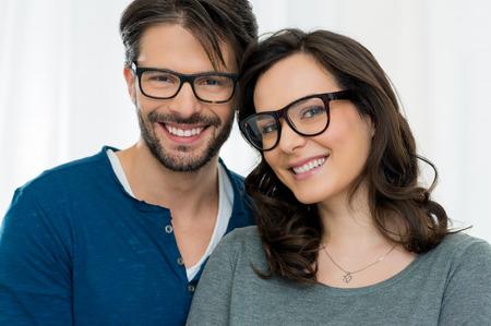 Photo pour Closeup of smiling couple wearing spectacle - image libre de droit