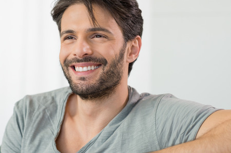 Photo pour Closeup of smiling man looking away - image libre de droit