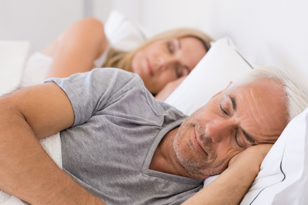 Photo pour Senior man and woman sleeping. Senior man and woman resting with eyes closed. Mature couple sleeping together in their bed. - image libre de droit