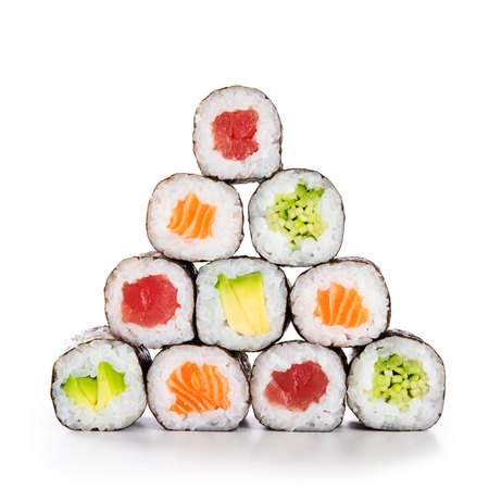 Foto de Fresh hosomaki in a pyramid isolated on white background. Sushi roll with salmon, tuna, avocado and cucumber. Traditional japanese food with maki. Delicious sushi pieces. - Imagen libre de derechos