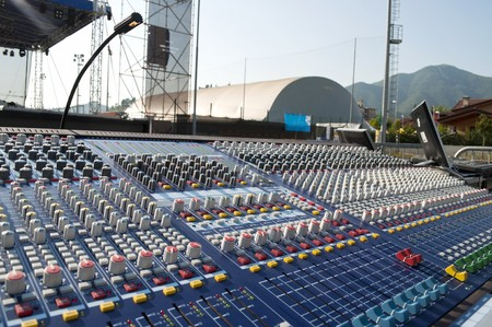 Big mixer console in a concert stage