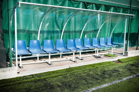 Coach and reserve benches in a soccer field