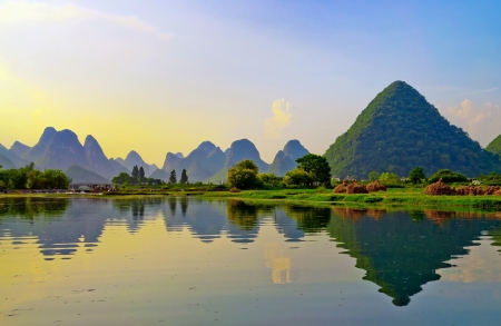 Reflection of the muntains in Li River landscape on sunset, Yangshuo near Guilin, China