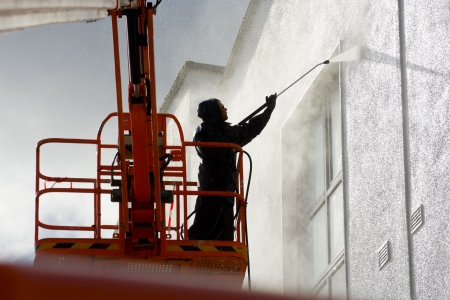 worker washing a wall