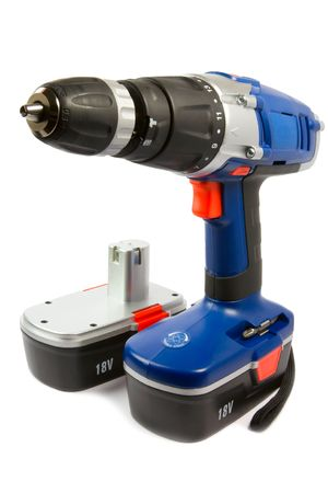 cordless hammer drill and spare rechargeable battery, isolated