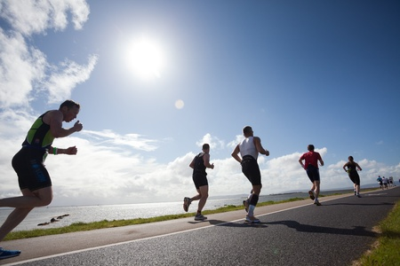 Photo pour GALWAY, IRELAND - SEPT 4: Unidentified athletes compete at first Edition of Galway Iron Man Triathlon on September 4, 2011 in Galway, Ireland - image libre de droit