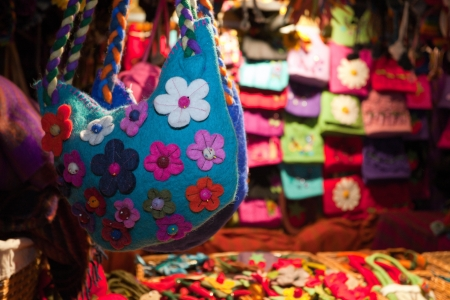 Handmade felt bags and flowers decorations at the market