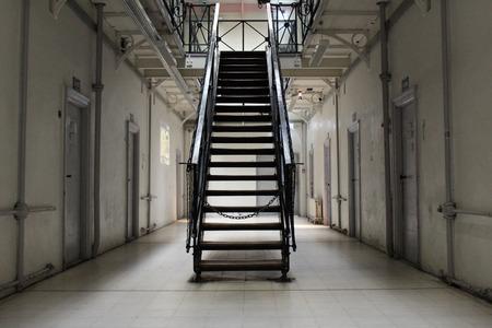 the hallway in a prison cell block