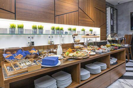 Photo pour Buffet table, breakfast in hotel restaurant - image libre de droit