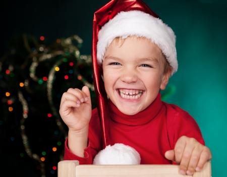 Happy small child in santa hat