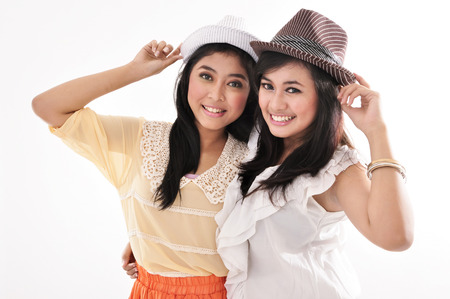 two beautiful girl wearing a hat, isolated on white background
