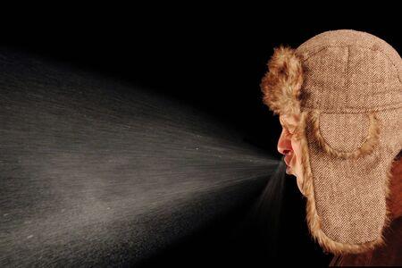 Young man sneezing