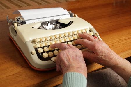 Grandma writing with an old typewriter