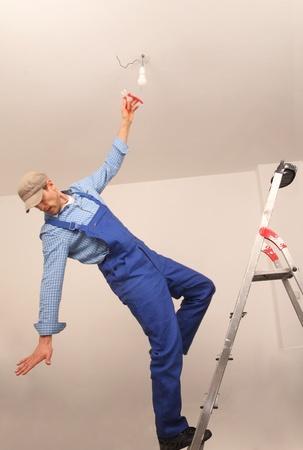 Photo pour Craftsman falling down a ladder - image libre de droit