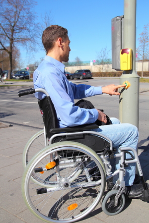 Wheelchairuser on a pedestrian crossing