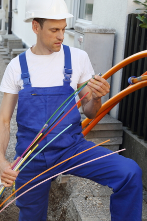 A Worker with Fiber optic broadband cable