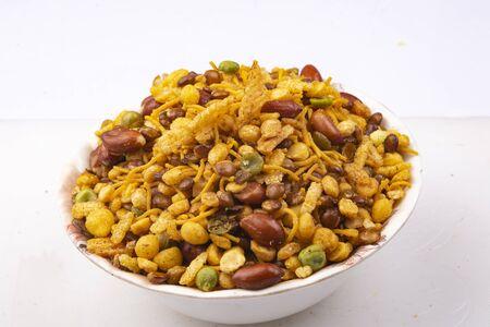 Photo pour traditional indian navratan mixture namkeen in bowl - image libre de droit