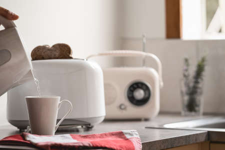 Photo pour Breakfast time with electric kettle, toaster and an old vintage radio. White background - image libre de droit