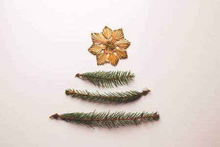 Foto de twigs of Christmas tree and toys from straw - Imagen libre de derechos