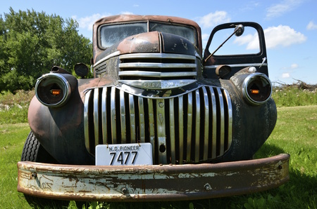 DOWNER, MINNESOTA, August 10, 2014: The old pickup from the 40's is a Chevrolet  colloquially referred to as Chevy and formally the Chevrolet Division of General Motors Company, is an American automobile division of the American manufacturer General Motor