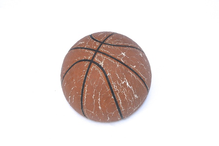 Photo pour An old leather basketball is laying in a snowdrift after a fresh snow.  (in white) - image libre de droit