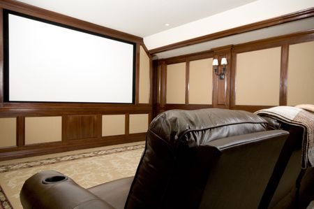 home theatre in a mansion with custom woodwork plush seats
