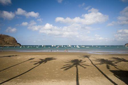 beach with coconut tree shadows bay of san juan del sur nicaragua central america